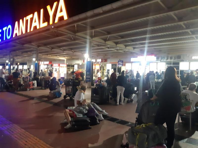 Ground stop: Thomas Cook passengers outside Antalya airport in Turkey in the early hours of Saturday morning, after their plane to Glasgow had a technical problem: Beka Whitelaw