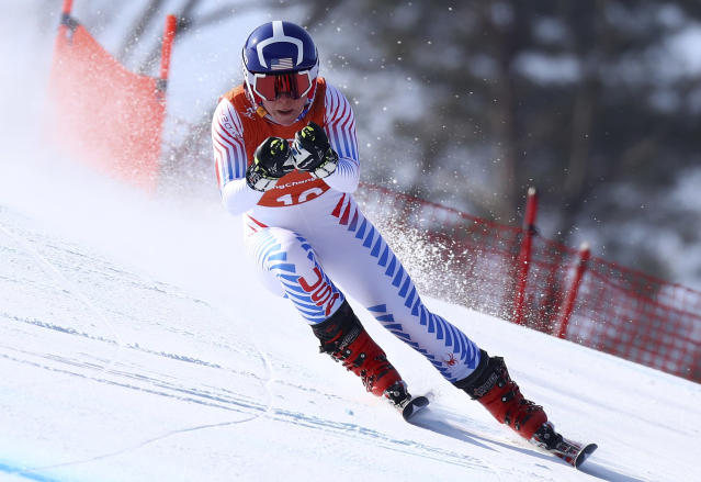 FILE - In this Feb. 20, 2018, file photo United States' Breezy Johnson competes in women's downhill training at the 2018 Winter Olympics in Jeongseon, South Korea. Johnson tore a ligament in her knee during a second straight offseason training session. (AP Photo/Alessandro Trovati, File)