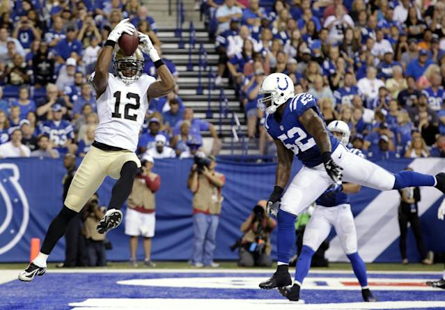 New Orleans Saints wide receiver Marques Colston (12) makes a catch for a touchdown in front of Indianapolis Colts inside linebacker D'Qwell Jackson during the first half of an NFL preseason football game in Indianapolis, Saturday, Aug. 23, 2014. (AP Photo/AJ Mast)