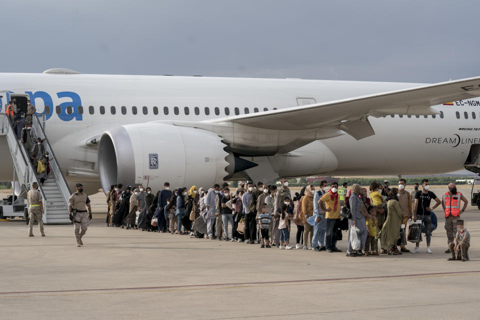 MADRID, SPAIN - AUGUST 23: Refugees after the arrival of a plane with 260 people from Afghanistan, at the Torrejon de Ardoz air base, 23 August 2021, in Madrid, Spain. A total of seven planes have departed from Kabul airport to the Torrejon base with Afghan evacuees and collaborators from Spain, after the country has been controlled by the Taliban. Spain has managed to evacuate a total of 566 Afghans, about half of whom have applied for asylum in Spain and 91 have already been transferred to reception centres. (Photo By A. Perez Meca/Europa Press via Getty Images)