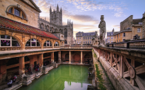 """<p>The natural hot springs in Bath have been soothing people ever since the Romans founded a settlement here in the 1st century AD. It was all three King Georges that made it the graceful spa city it is today, with the addition of its now-famous golden architecture. The Roman remains include the Temple of Sulis Minerva and the baths complex, based around the hot springs in the centre of the Empire town of Aquae Sulis. Head up to the top of the Thermae Bath Spa to take the waters in style – the pool has an incredible view of the city and the abbey.</p><p><strong>Where to stay:</strong> The <a href=""""https://www.royalcrescent.co.uk/"""" rel=""""nofollow noopener"""" target=""""_blank"""" data-ylk=""""slk:Royal Crescent Hotel"""" class=""""link rapid-noclick-resp"""">Royal Crescent Hotel</a> is set in the iconic curving terrace, built in 1775. The <a href=""""https://www.thegainsboroughbathspa.co.uk/"""" rel=""""nofollow noopener"""" target=""""_blank"""" data-ylk=""""slk:Gainsborough"""" class=""""link rapid-noclick-resp"""">Gainsborough</a> takes spa days seriously, with its own spa village and thermal pools.</p>"""