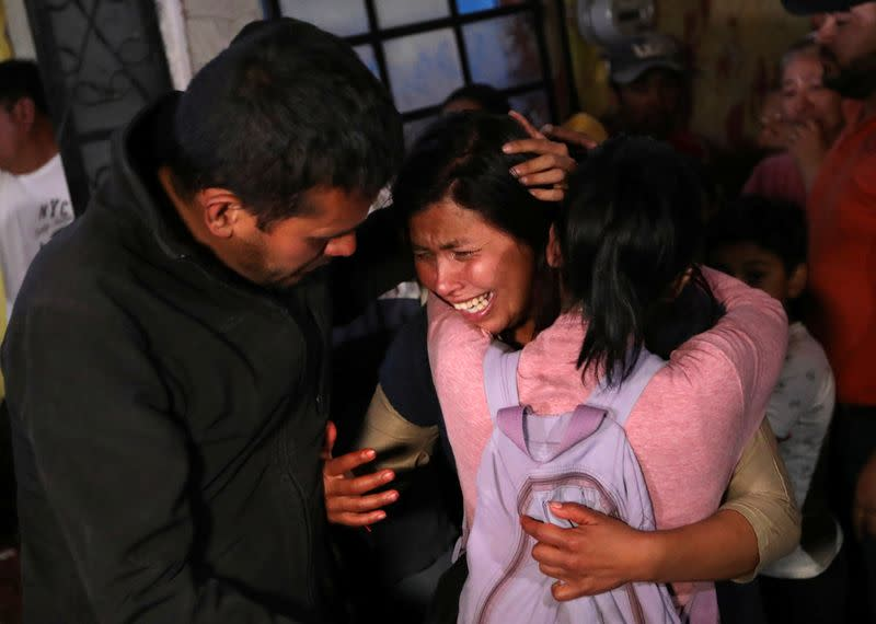 Maria Magdalena, mother of Fatima Cecilia Aldrighett, who went missing and whose body was discovered over the weekend inside plastic garbage bag, reacts as Fatima's coffin arrives at their house in Mexico City