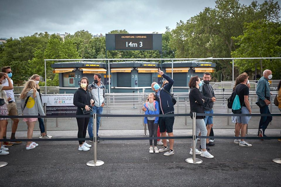 The first visitors to the Eiffel Tower in over 8 months queue to enter on July 16, 2021 in Paris, France.