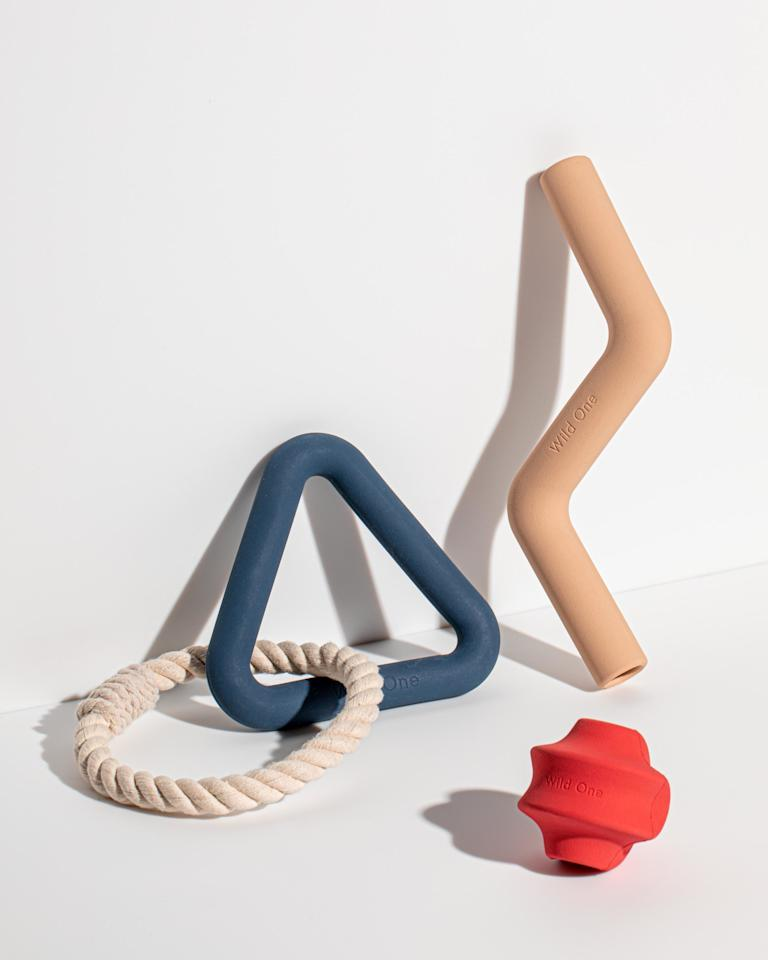 "<p>When we first spotted these dogs toys, we just figured they were some kind of minimalist design objects. That is, until we could out that the brand, <a href=""https://wildone.com/"" rel=""nofollow"">Wild One</a>, recently launched this collection of three new products: the Triangle Tug, Bolt Bite, and Twist Toss. Each toy comes in tan, red, or navy, and is developed for different kinds of play. Clueless about which one your dog will love? Wild One created a <a href=""https://wildone.com/blogs/content/dog-toys-for-every-style-of-play?utm_campaign=Toy_Teaser_Quiz_071619%20%28L3YnqP%29&utm_medium=email&utm_source=WO%20Marketing%20Master%20List&_ke="" rel=""nofollow"">quiz</a> to help owners ""prescribe"" dogs the ideal toy based on their style of play!</p> <p>Even better? The brand makes easy-on-the-eyes beds, bowls, leashes, and harnesses, too. They'll be releasing a starter kit on August 15, in which you can get one of everything you need. 🙏</p>"