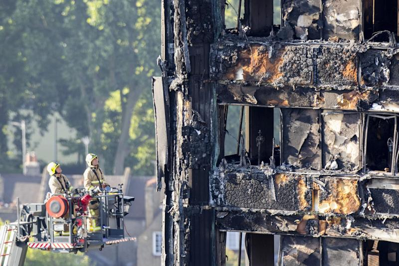 Fire service personnel survey the damage to Grenfell Tower: PA