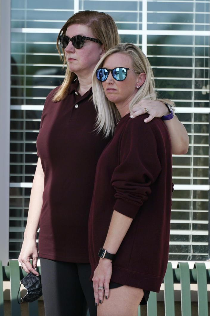 Sara Wiles, left, stands with Hollie Skaggs after they both spoke at a prayer vigil at the Collierville Town Hall Friday, Sept. 24, 2021, in Collierville, Tenn. Both Wiles and Skaggs were shopping in a Kroger grocery store Thursday when a gunman attacked, killing one person and injuring others, before he was found dead of an apparent self-inflicted gunshot wound. (AP Photo/Mark Humphrey)