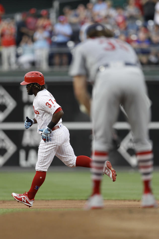 Philadelphia Phillies' Odubel Herrera, left, rounds the bases after hitting a three-run home run off St. Louis Cardinals starting pitcher Miles Mikolas, right, during the first inning of a baseball game, Monday, June 18, 2018, in Philadelphia. (AP Photo/Matt Slocum)