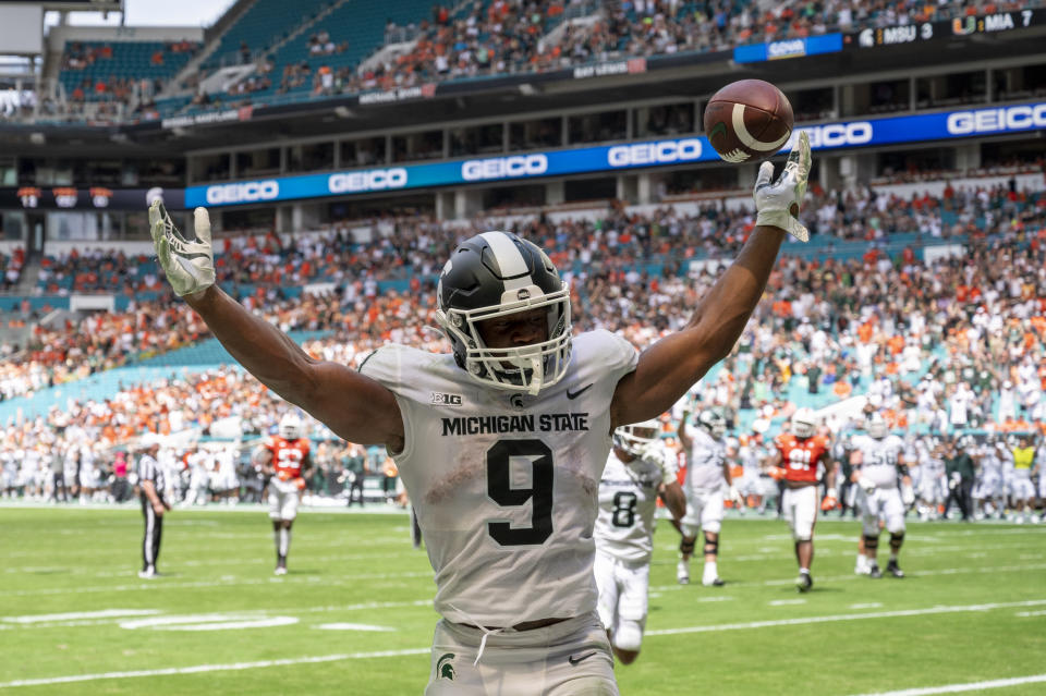 Michigan State running back Kenneth Walker III (9) celebrates scoringt a touchdown against Miami during an NCAA football game on Saturday, Sept 18, 2021 in Miami Gardens, Fla. (AP Photo/Doug Murray)