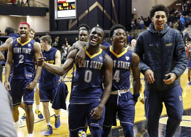 Kent State players BJ Duling (2), Jalen Avery (0), and Antonio Williams (4) celebrate as they leave the court after defeating Vanderbilt 77-75 in an NCAA college basketball game Friday, Nov. 23, 2018, in Nashville, Tenn. (AP Photo/Mark Humphrey)