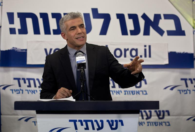 """Yair Lapid gestures as he delivers a speech at his """"Yesh Atid"""" party in Tel-Aviv, early Wednesday, Jan. 23, 2013. The party, formed just over a year ago, out did forecasts by far and are predicted to capture as many as 19 seats, becoming parliament's second-largest party, after Netanyahu's Likud-Beiteinu bloc, which won 31, according to the exit polls. (AP Photo/Sebastian Scheiner)"""