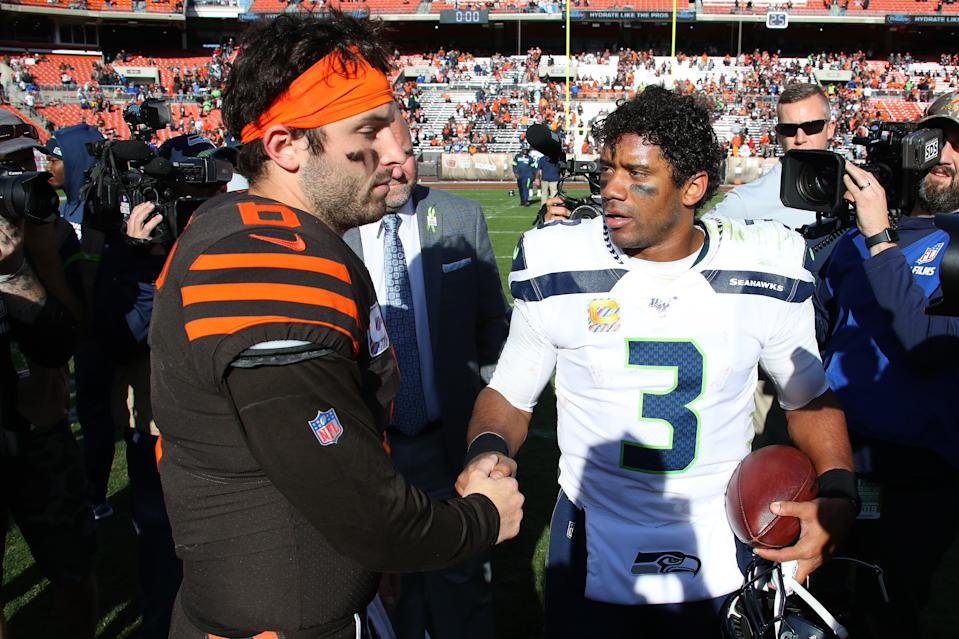 Russell Wilson of the Seattle Seahawks shakes hands with Baker Mayfield of the Cleveland Browns after a 32-28 Seahawks win. (Getty Images)