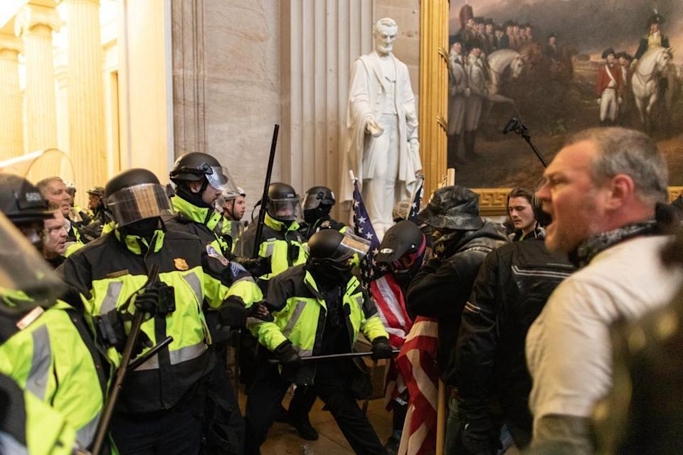 Police intervenes in US President Donald Trumps supporters who breached security and entered the Capitol building in Washington D.C., United States on January 06, 2021. (Mostafa Bassim/Anadolu Agency via Getty Images)