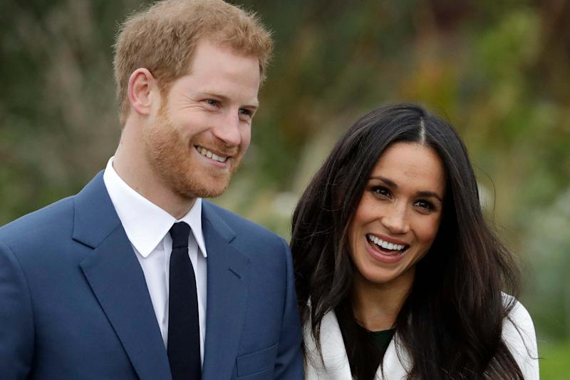 Harry and Meghan sparked a royal crisis by announcing they were stepping back as 'senior' members of the royal family (AP)