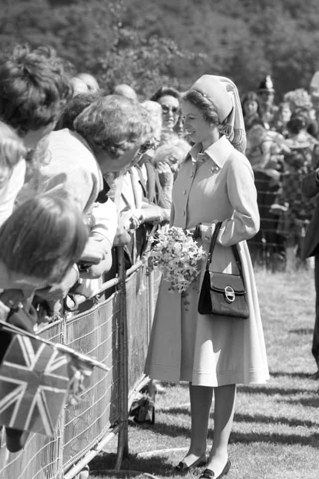 <p>Who could forget Princess Anne's seriously chic maternity wardrobe? Here, the royal is pictured on a trip to West Yorkshire back in November 1977. She was expecting her first child, Peter Phillips, at the time. <em>[Photo: Getty]</em> </p>