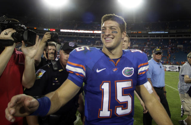 Florida quarterback Tim Tebow is all smiles following the Gators 41-17 win over Georgia during an NCAA college football game, Saturday, Oct. 31, 2009, in Jacksonville, Fla.(AP Photo/Phil Coale)