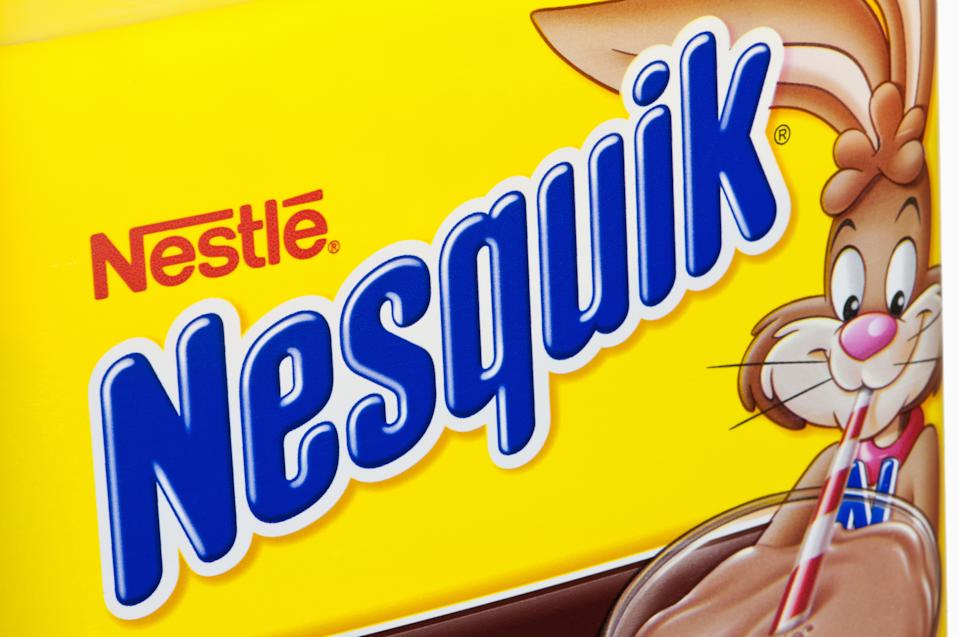 Minneapolis, Minnesota - July 9, 2011: Nestle Nesquik Container.  A close-up view of a Nestle Nesquik container with the classic yellow and blue label.  Nestle is the largest food and nutrition company in the world with headquarters in Vevey, Switzerland.  Nesquik has been America\'s #1 flavored milk for over 50 years.