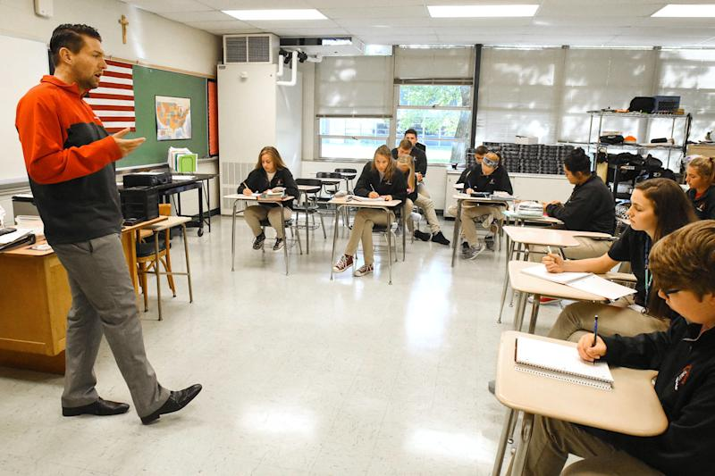 Jordan Miller teaches a junior English class at Bishop Luers High School in Fort Wayne. (Cathie Rowand/The Journal Gazette)