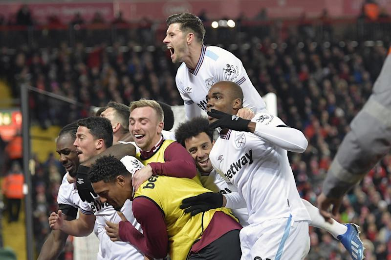 In the thick of it: Bowen (centre, in bib) celebrates with his team-mates after Pablo Fornals' goal at Anfield on Monday (West Ham United FC via Getty Ima)