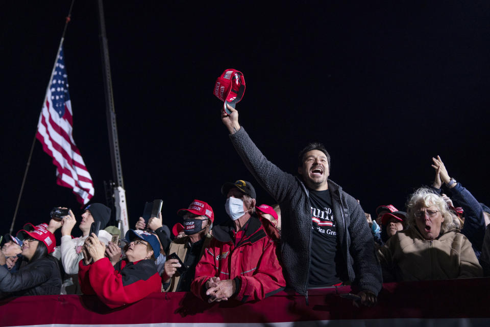 Supporters of President Donald Trump cheer as he arrives for a campaign rally at Richard B. Russell Airport, Sunday, Nov. 1, 2020, in Rome, Ga. (AP Photo/Evan Vucci)