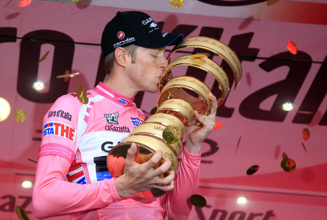 Canadian Garmin team cyclist Ryder Hesjedal kisses his trophy after winning the Tour of Italy (Giro d'Italia) cycling race on May 27, 2012 in Milano. AFP PHOTO / LUK BENIESLUK BENIES/AFP/GettyImages