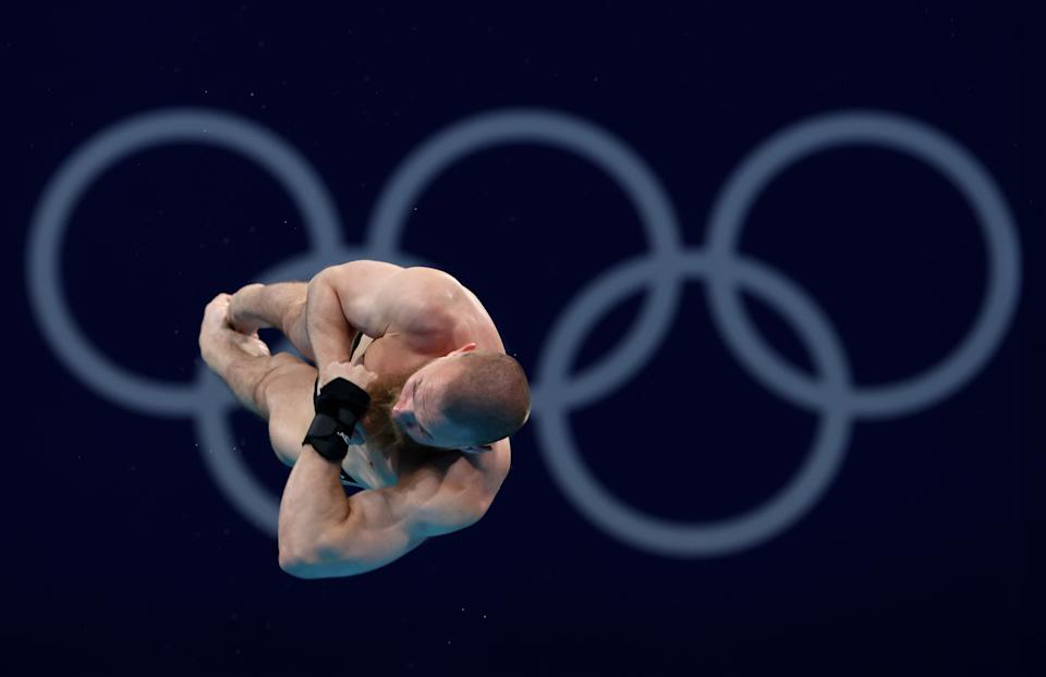 <p>Evgeny Kuznetsov of Team ROC competes in the Men's 3m Springboard Final on day eleven of the Tokyo 2020 Olympic Games at Tokyo Aquatics Centre on August 03, 2021 in Tokyo, Japan. (Photo by Clive Rose/Getty Images)</p>