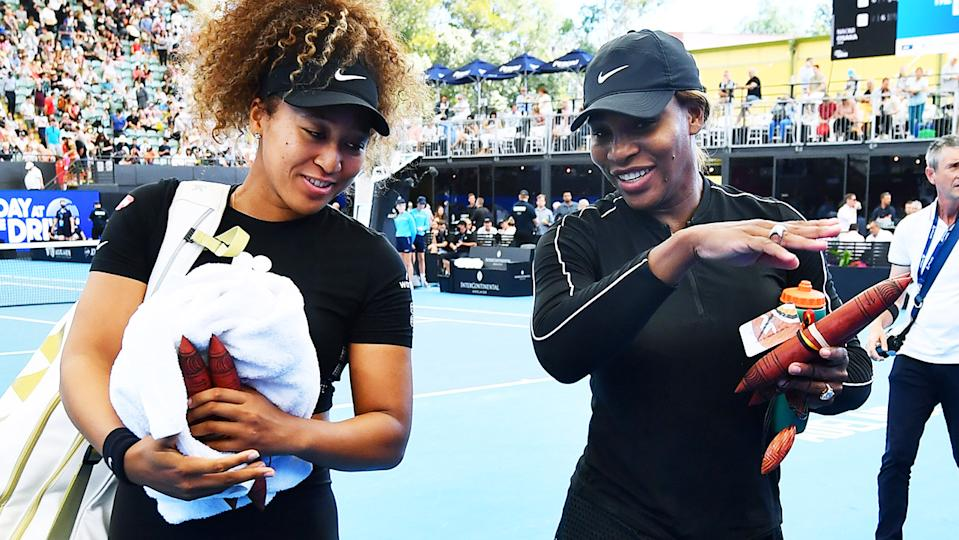 Naomi Osaka and Serena Williams, pictured here leaving the court together.