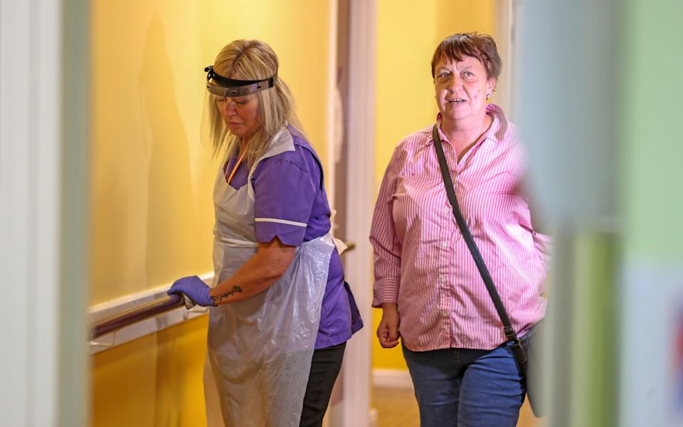 Care worker Jane Ward and resident Zoe McCullough on her rounds at Ashwood Court residential care home in Lowton, Warrington - Peter Byrne/PA