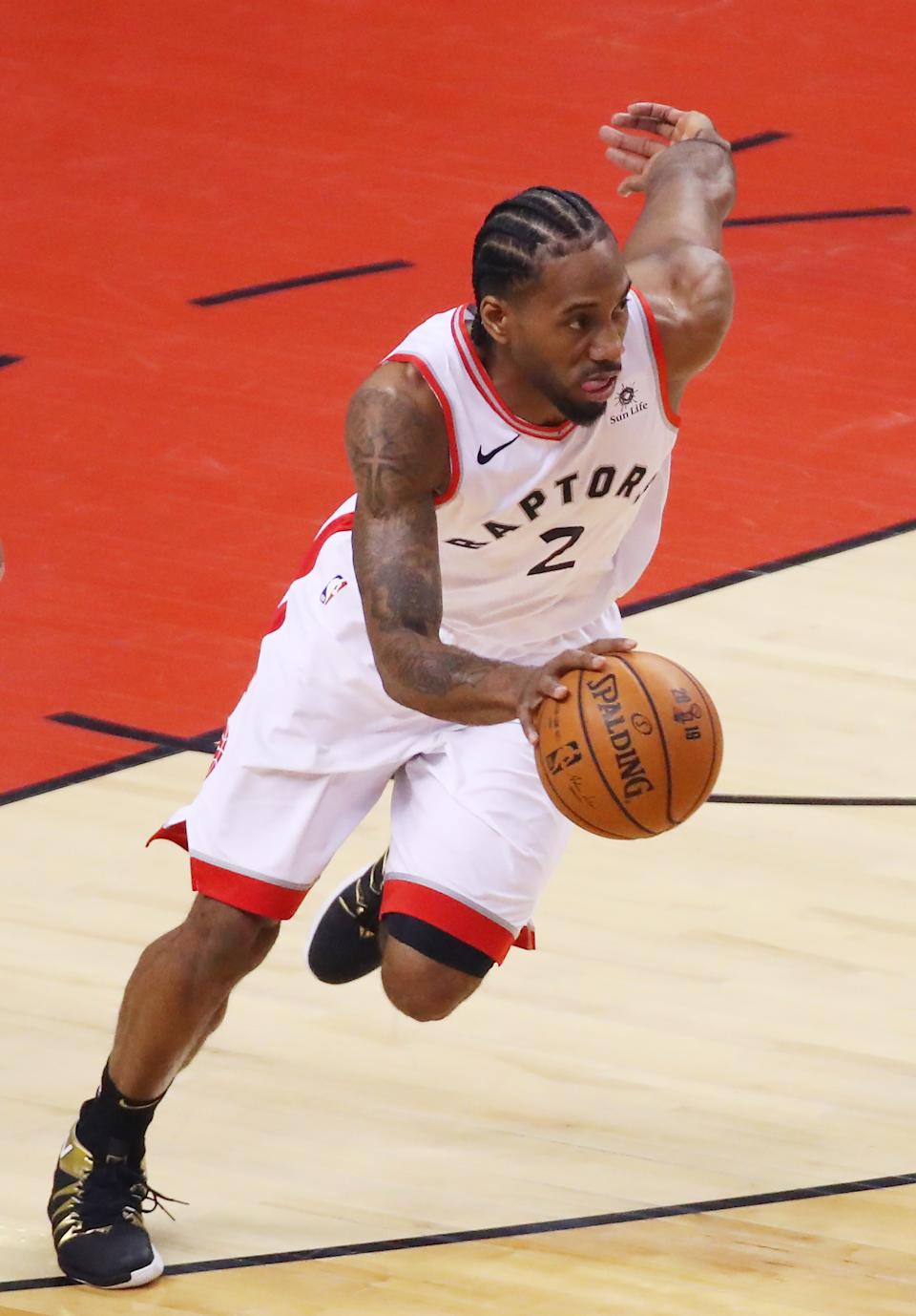 Kawhi Leonard #2 of the Toronto Raptors handles the ball on offense against the Golden State Warriors in the first quarter during Game One of the 2019 NBA Finals at Scotiabank Arena on May 30, 2019 in Toronto, Canada. (Photo by Gregory Shamus/Getty Images)
