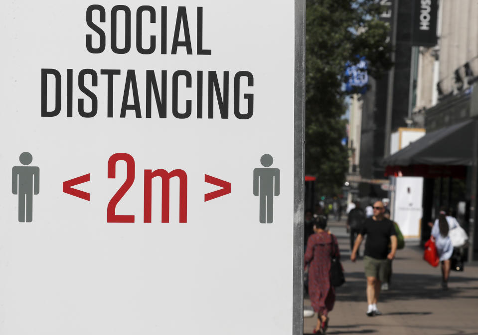 Social distancing sign in London (AP)
