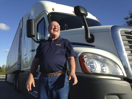 Bob Wyatt, who has driven more than 4 million miles over four decades for truck firm Schneider National, is pictured outside the company's headquarters in Green Bay, Wisconsin, U.S. October 1, 2015. The trucking industry is short on drivers and a new regulation mandating truckers switch to electronic logs is expected to make the shortage far worse. REUTERS/Nick Carey