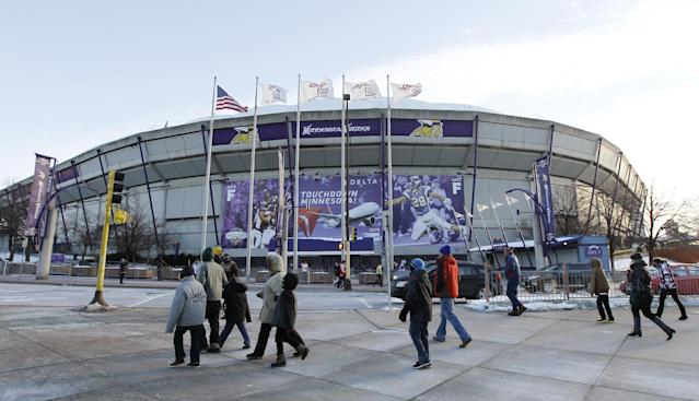 Fans walk outside the Mall of America Field at the Hubert H. Humphrey Metrodome before an NFL football game between the Minnesota Vikings and the Detroit Lions, Sunday, Dec. 29, 2013, in Minneapolis. The Vikings are playing their final game in the Metrodome, as it will be torn down following the season. (AP Photo/Ann Heisenfelt)
