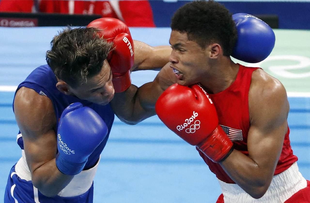 United States' Shakur Stevenson, right, and Cuba's Robeisy Ramirez exchange punches during a men's bantamweight 56-kg final boxing match at the 2016 Summer Olympics in Rio de Janeiro, Brazil, Saturday, Aug. 20, 2016. (AP Photo/Vincent Thian)