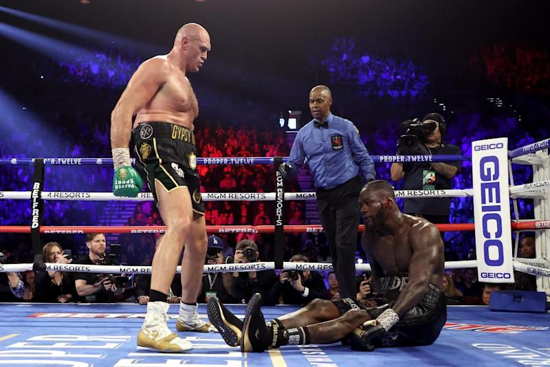 Fury knocks down Deontay Wilder in the fifth round.