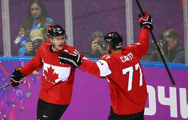 SOCHI, RUSSIA - FEBRUARY 23: Jonathan Toews #16 of Canada celebrates with Jeff Carter #77 of Canada after scoring a goal against Sweden in the first period during the Men's Ice Hockey Gold Medal match on Day 16 of the 2014 Sochi Winter Olympics at Bolshoy Ice Dome on February 23, 2014 in Sochi, Russia. (Photo by Streeter Lecka/Getty Images)