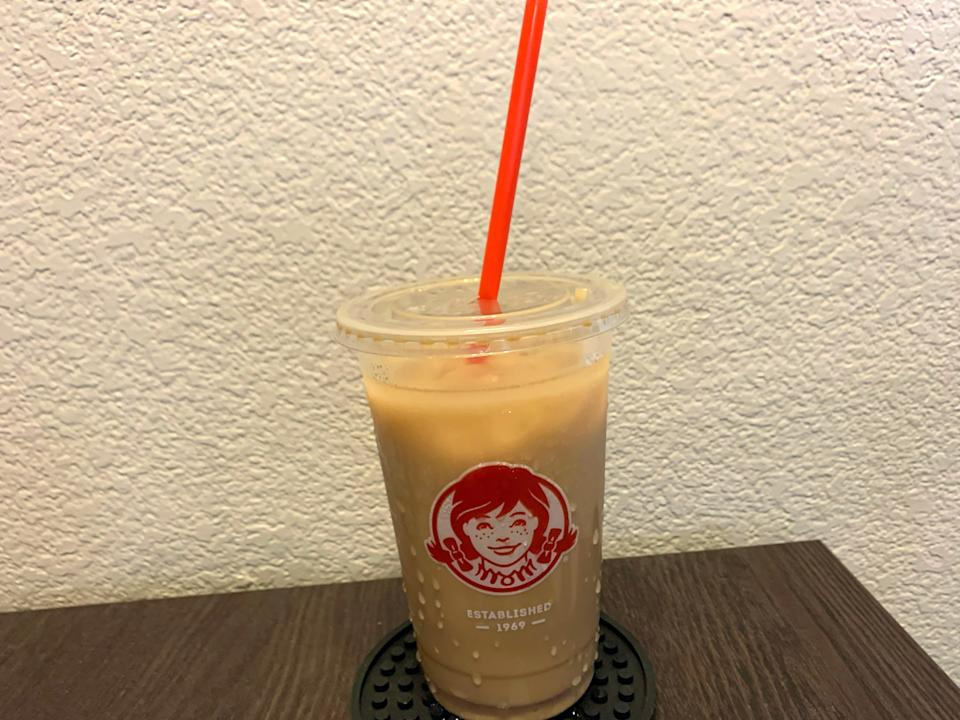 Wendy's iced coffee on wooden table
