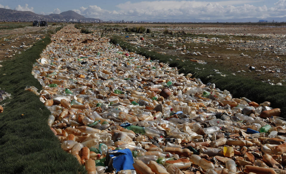 Plastic bottles and other garbage floats on the Tagaret River which flows into Uru Uru Lake, near Oruro, Bolivia, Thursday, March 25, 2021. (AP Photo/Juan Karita)