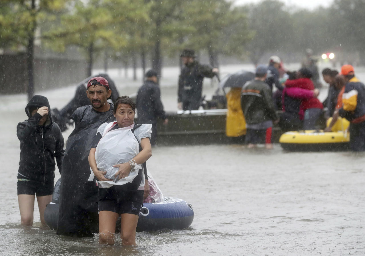 <p>People are evacuated from rising floodwaters in a neighbourhood as downpours from Tropical Storm Harvey continue in Fort Bend County, Texas. (AP) </p>