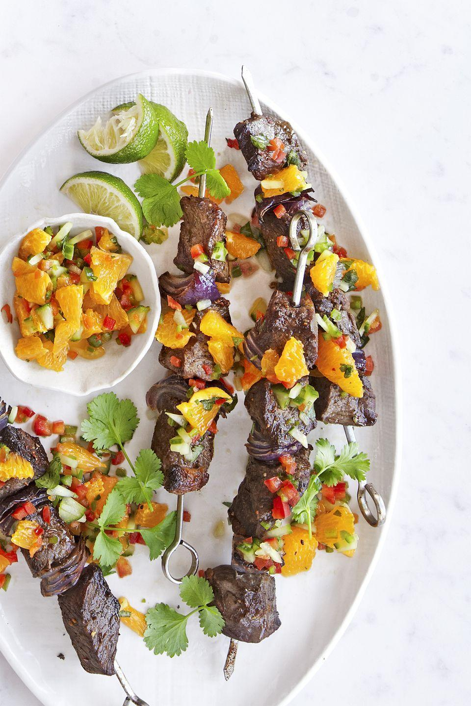 """<p>Made on the grill or in your oven, these steak kabobs are perfect for any time of year.</p><p><strong><a href=""""https://www.countryliving.com/food-drinks/recipes/a41071/broiled-steak-kabobs-with-orange-relish/"""" rel=""""nofollow noopener"""" target=""""_blank"""" data-ylk=""""slk:Get the recipe"""" class=""""link rapid-noclick-resp"""">Get the recipe</a>.</strong> </p>"""