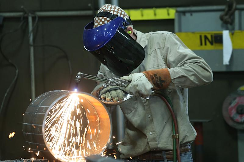 MARIETTA, OH - OCTOBER 25: An employee welds pipe at Pioneer Pipe on October 25, 2016 in Marietta, Ohio. The construction, maintenance and fabrication company employs around 800 people, supplying products to the oil and gas industry. (Photo by Spencer Platt/Getty Images)