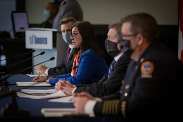 Mayor John Tory and Dr. Eileen de Villa, the city's medical officer of health, and Toronto Fire Chief Matthew Pegg hold a COVID-19 briefing on Jan. 4, 2020.  (Evan Mitsui/CBC - image credit)