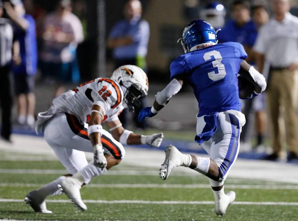 Weatherford's Dezmond Forrest (3) outruns Haltom's Johnny Smith-Rider (22) for a touchdown in the second quarter. The Haltom Buffalos played the Weatherford Kangaroos at Kangaroo Stadium in Weatherford Thursday, Oct. 3, 2019.