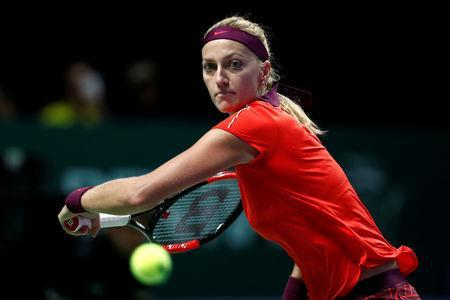 FILE PHOTO: Tennis - WTA Tour Finals - Singapore Indoor Stadium, Kallang, Singapore - October 25, 2018 Czech Republic's Petra Kvitova in action during her group stage match against Czech Republic's Karolina Pliskova REUTERS/Edgar Su