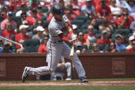 Minnesota Twins' Andrelton Simmons hits a two-run single during the second inning of a baseball game against the St. Louis Cardinals on Sunday, Aug. 1, 2021, in St. Louis. (AP Photo/Joe Puetz)