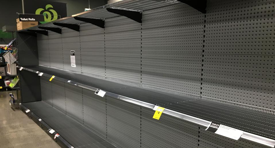 Photo shows empty shelves in a Woolworths store due to coronavirus panic buying.