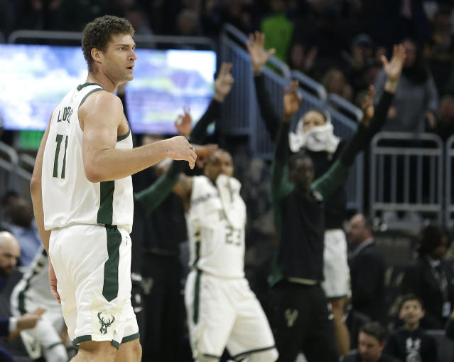 Milwaukee Bucks' Brook Lopez reacts after making a three-point basket during the second half of an NBA basketball game against the Los Angeles Clippers, Thursday, March 28, 2019, in Milwaukee. (AP Photo/Aaron Gash)