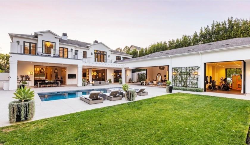 The nearly 13,000-square-foot showplace includes seven bedrooms, 12 bathrooms, a pool, tennis court, pool house and subterranean garage.