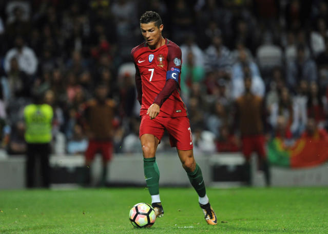 FILE - In this Thursday Aug. 31, 2017 file photo, Portugal's Cristiano Ronaldo scores his side's fourth goal during the World Cup Group B qualifying soccer match between Portugal and Faroe Islands at the Bessa Stadium in Porto, Portugal. (AP Photo/Paulo Duarte, File)