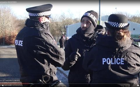 Joey Carbstrong discussing animal rights with police during one protest