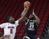Wake Forest's Isaiah Wilkins (23) shoots as North Carolina State's D.J. Funderburk (0) defends during the first half of an NCAA college basketball game Wednesday, Jan. 27, 2021, in Raleigh, N.C. (Ethan Hyman/The News & Observer via AP, Pool)