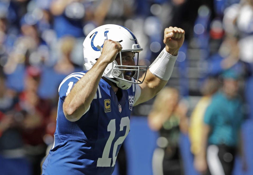 Indianapolis Colts' Andrew Luck reacts after throwing a touchdown pass during the first half of an NFL football game against the Houston Texans, Sunday, Sept. 30, 2018, in Indianapolis. (AP Photo/Darron Cummings)